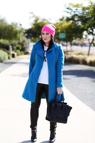 How to wear: black leather ankle boots, black leather skinny pants, white and black print long sleeve t-shirt, blue coat