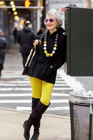 How to wear: black suede over the knee boots, yellow skinny pants, yellow long sleeve t-shirt, black poncho