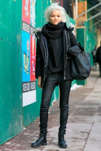 How to wear: black leather lace-up flat boots, black leather skinny pants, black knit oversized sweater, black parka