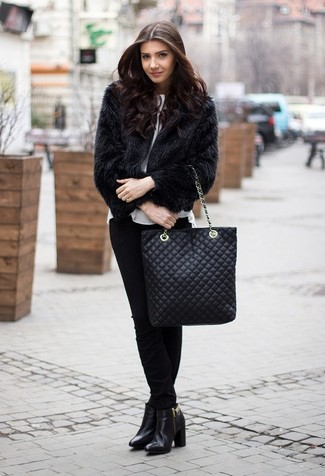 How to wear: black leather ankle boots, black skinny pants, white short sleeve blouse, black fur jacket