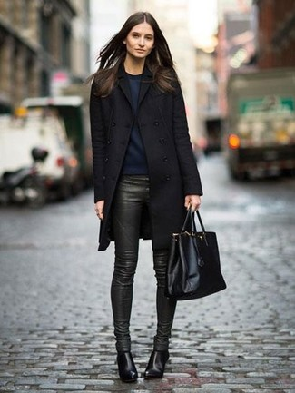 How to wear: black leather ankle boots, dark green leather skinny pants, navy sweatshirt, black coat
