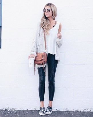 How to wear: white and black leopard slip-on sneakers, black quilted leather skinny pants, white tank, white knit open cardigan