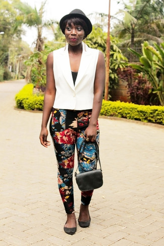 How to wear: black suede ballerina shoes, black floral skinny pants, black tank, white vest