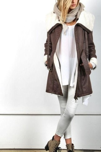 How to wear: brown suede lace-up ankle boots, white leather skinny pants, white tunic, dark brown shearling coat