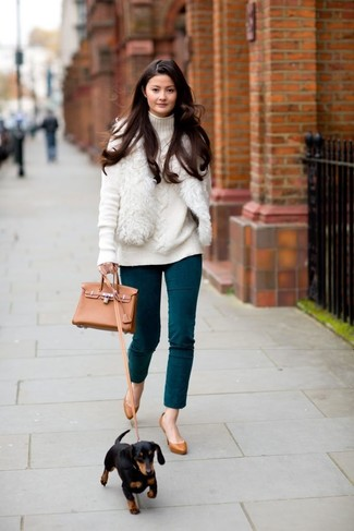 How to wear: tobacco leather pumps, teal skinny pants, white knit turtleneck, white fur vest