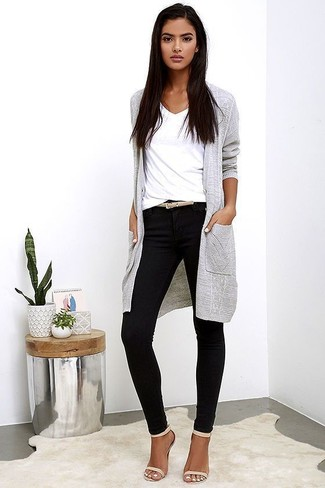 How to Wear a Long Cardigan In Your 20s In Warm Weather Smart Casually: For a casual ensemble, try teaming a long cardigan with black skinny pants — these pieces fit really well together. And if you want to effortlesslly polish up your ensemble with one item, complement your ensemble with beige leather heeled sandals.