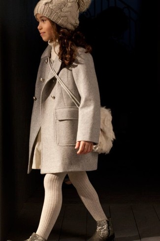How to Wear a Beige Beanie For Girls: Consider dressing your daughter in a beige coat with a beige beanie for a laid-back yet fashion-forward outfit. Gold boots are a good choice to finish off this getup.