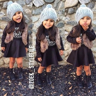 How to wear: black boots, black skirt, black sweater, brown fur vest