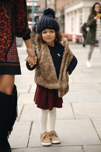 How to wear: tan sneakers, burgundy skirt, black sweater, brown fur vest
