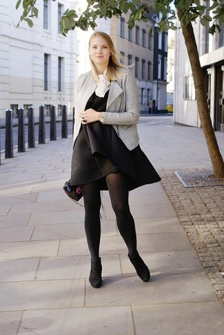 How to wear: black suede ankle boots, white silk sleeveless top, black swing dress, grey leather biker jacket