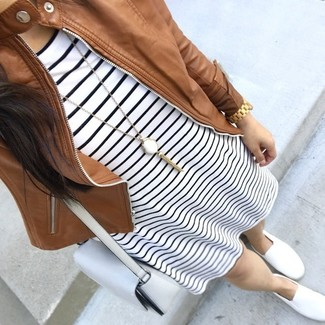 How to wear: white leather crossbody bag, white slip-on sneakers, white and black horizontal striped casual dress, brown leather bomber jacket