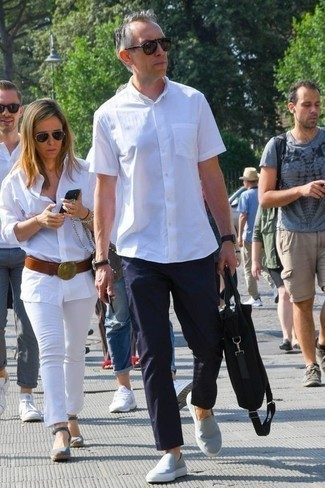 Men's Looks & Outfits: What To Wear In 2020: This laid-back pairing of a white short sleeve shirt and navy chinos can only be described as devastatingly sharp. When it comes to shoes, introduce a pair of grey canvas slip-on sneakers to the equation.