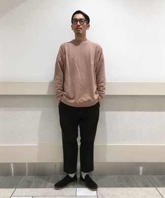 Men's Looks & Outfits: What To Wear In 2020: Opt for a pink sweatshirt and black chinos to create an everyday outfit that's full of charisma and character. Let your sartorial sensibilities really shine by finishing this outfit with a pair of black canvas slip-on sneakers.