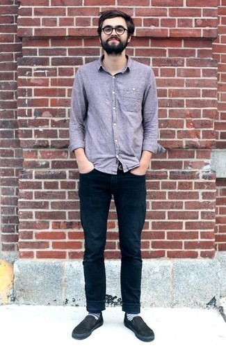 Men's Looks & Outfits: What To Wear In 2020: This combination of a light violet chambray long sleeve shirt and navy jeans makes for the perfect foundation for a myriad of stylish combos. Consider black canvas slip-on sneakers as the glue that ties your outfit together.