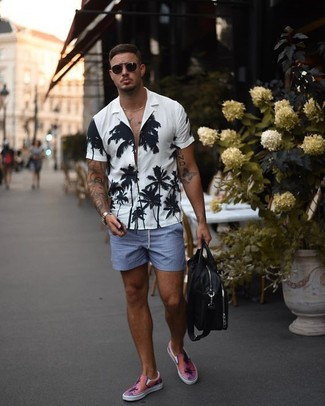 How to wear: black leather messenger bag, pink slip-on sneakers, blue shorts, white and black floral short sleeve shirt
