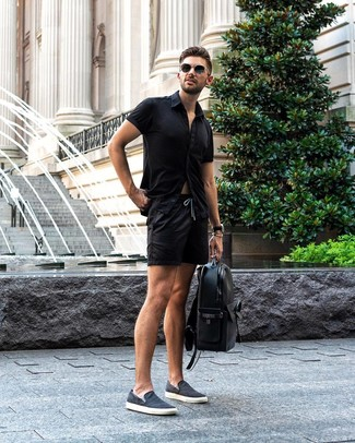 How to wear: black leather backpack, navy canvas slip-on sneakers, black shorts, black short sleeve shirt