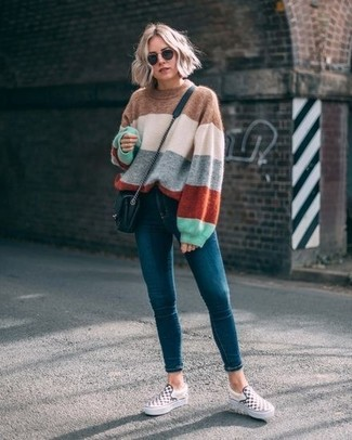 How to wear: black quilted leather crossbody bag, white and black check slip-on sneakers, teal skinny jeans, multi colored horizontal striped oversized sweater