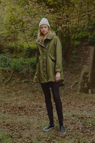 How to wear: grey beanie, black leather slip-on sneakers, black skinny jeans, olive parka