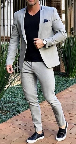 How to wear: black silk pocket square, black leather slip-on sneakers, black v-neck t-shirt, grey suit