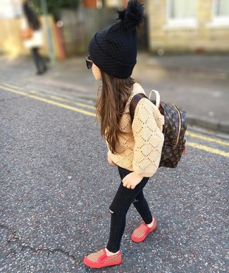 How to Wear a Black Beanie For Girls: Suggest that your darling wear a tan sweater with a black beanie for a fun day in the park. Red sneakers are a smart choice to finish off this getup.