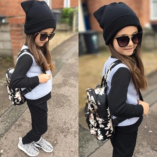 How to Wear a Black Beanie For Girls: Your kid will look adorable in a grey jacket and a black beanie. Grey sneakers are a good choice to finish off this style.