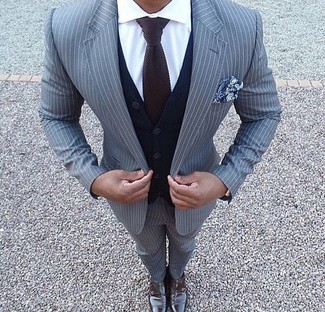 How to wear: grey vertical striped suit, navy cardigan, white dress shirt, dark brown leather double monks