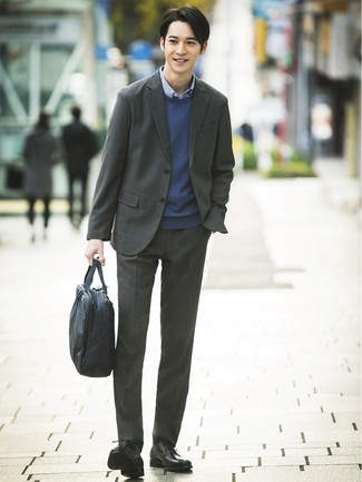 How to wear: charcoal suit, navy crew-neck sweater, blue gingham long sleeve shirt, black leather derby shoes