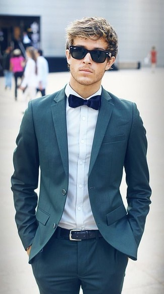 How to wear: teal suit, light blue dress shirt, navy velvet bow-tie, navy leather belt