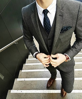 How to wear: grey wool suit, white dress shirt, brown leather brogues, black and white polka dot tie