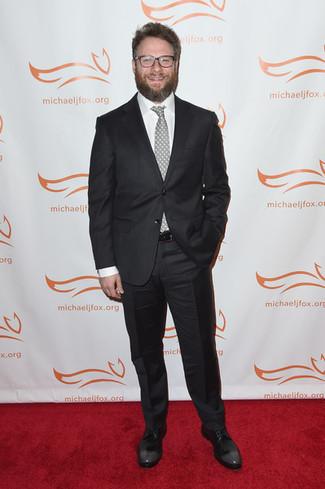 Seth Rogen wearing Black Suit, White Dress Shirt, Black Leather Derby Shoes, Grey Polka Dot Tie