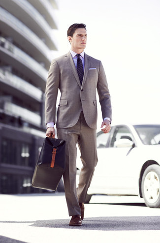 How to wear: grey suit, violet dress shirt, brown leather derby shoes, black leather holdall