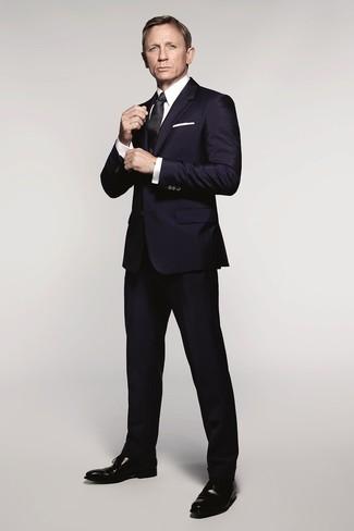 Daniel Craig wearing Navy Suit, White Dress Shirt, Black Leather Oxford Shoes, Black Silk Tie