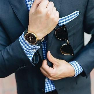 How to wear: navy suit, blue gingham dress shirt, blue gingham pocket square, black sunglasses