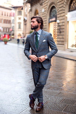How to wear: grey check wool suit, white and navy vertical striped dress shirt, dark brown leather tassel loafers, dark green print tie