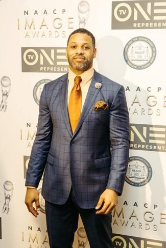 How to wear: navy check suit, beige dress shirt, orange tie, orange floral pocket square