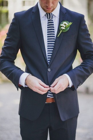 How to wear: navy suit, white dress shirt, navy and white horizontal striped tie, green lapel pin