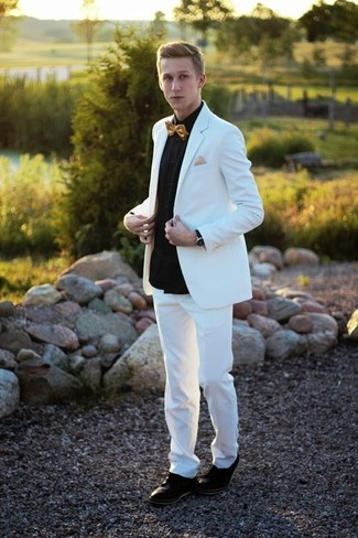 Consider wearing a white and purple suit and a black long sleeve shirt for a sharp