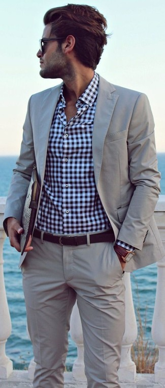 How to wear: grey suit, white and navy gingham long sleeve shirt, dark brown leather zip pouch, dark brown leather belt