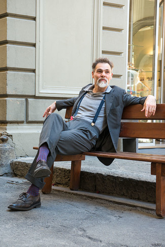 Simone Righi wearing Grey Suit, Grey Polo, Dark Brown Leather Brogues, Navy Suspenders