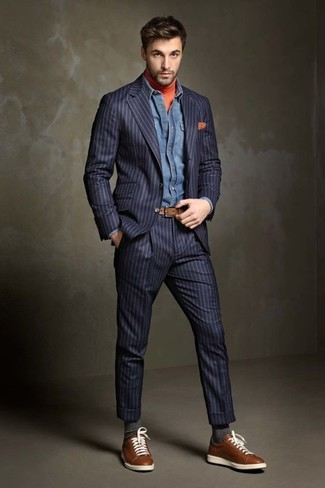 How to wear: navy vertical striped suit, orange turtleneck, blue denim shirt, brown leather low top sneakers