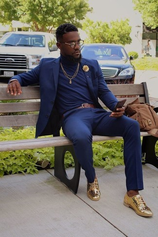 How to wear: navy suit, navy turtleneck, gold leather tassel loafers, brown canvas backpack