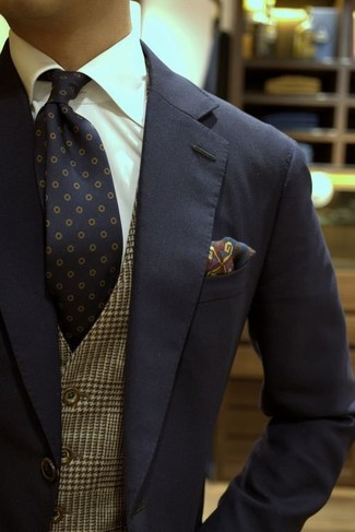 How to wear: navy suit, brown plaid waistcoat, white dress shirt, navy polka dot tie