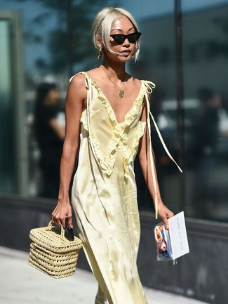 How to wear: gold pendant, black sunglasses, beige straw handbag, yellow satin maxi dress