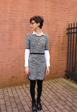 How to wear: grey sweater dress, white dress shirt, black leather ankle boots, gold pendant