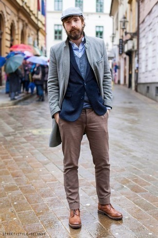 Men's Looks & Outfits: What To Wear In Winter: The formula for casually neat menswear style? A grey overcoat with brown chinos. Our favorite of a countless number of ways to complete this look is tobacco leather casual boots. A practical illustration of comfortable fashion, this ensemble must be in your front hall closet this winter.
