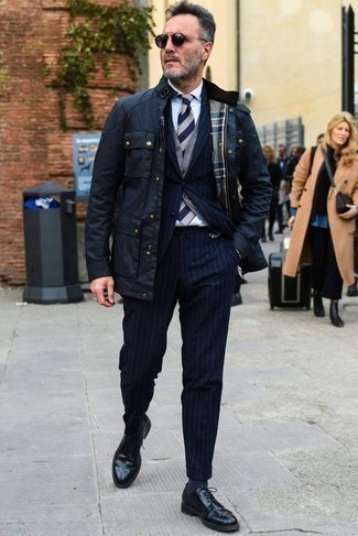 Men's Looks & Outfits: What To Wear In a Dressy Way: This combination of a navy field jacket and a navy vertical striped suit is a must-try casually classic outfit for any man. Black leather derby shoes are guaranteed to bring a touch of sophistication to your getup.