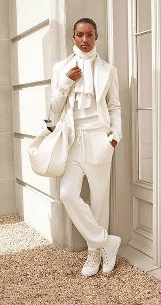 How to wear: white canvas high top sneakers, white sweatpants, white crew-neck sweater, white wool blazer