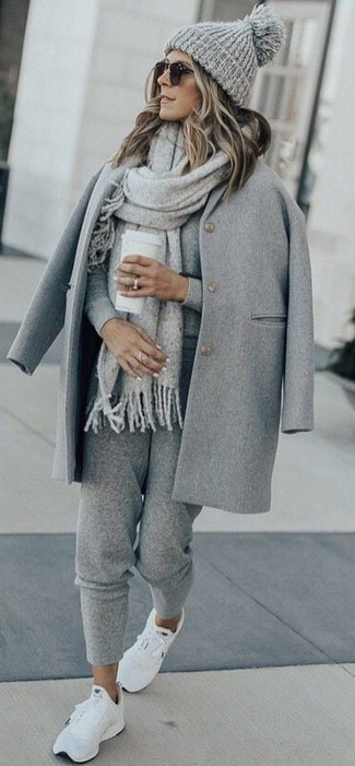 How to wear: white athletic shoes, grey sweatpants, grey crew-neck sweater, grey coat