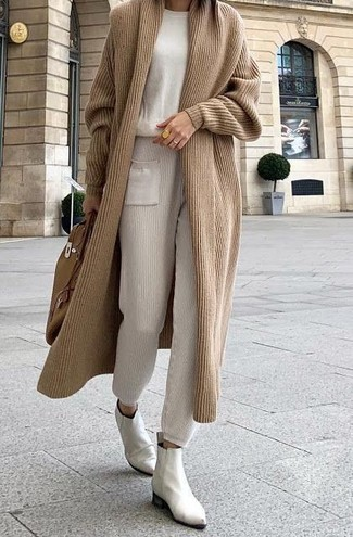 How to wear: white leather chelsea boots, beige sweatpants, beige crew-neck sweater, tan long cardigan