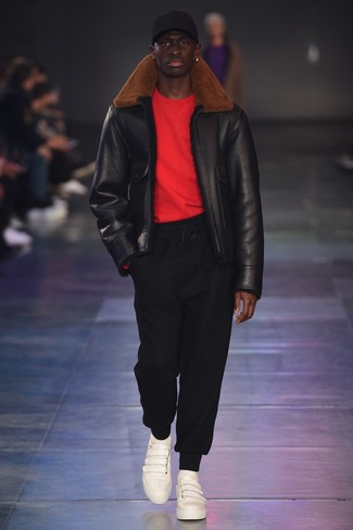 How to wear: white leather low top sneakers, black sweatpants, red crew-neck sweater, black shearling jacket